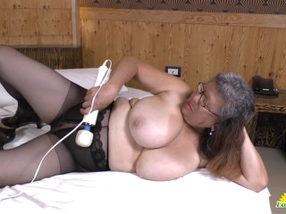 Latin BBW Granny plays with big vibrator