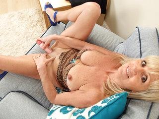British gilf Dolly dildos her fabulous fanny