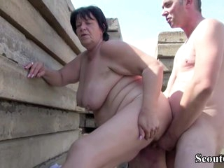 Fat German mature woman and her horny neighbour are having a good fuck, while outdoors